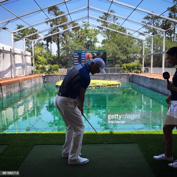 Martin Kaymer of Germany and Sky Sports' Henni Zuel compete in a contest on the replica 17th hole Stadium Village during practice for THE PLAYERS...