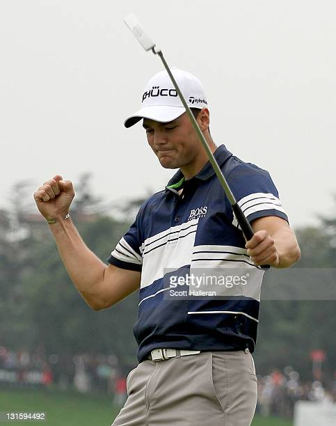 Martin Kaymer of Germany celebrates a birdie putt on the 18th green during the final round of the WGCHSBC Champions at Sheshan International Golf...