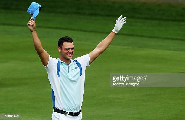 Martin Kaymer of Germany celebrates after holing a shot for eagle on the par 5 13th hole during the first round of the 95th PGA Championship on...