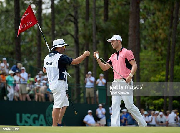 Martin Kaymer of Germany celebrates an eagle on the fifth green with his caddie Craig Connelly during the third round of the 114th US Open at...