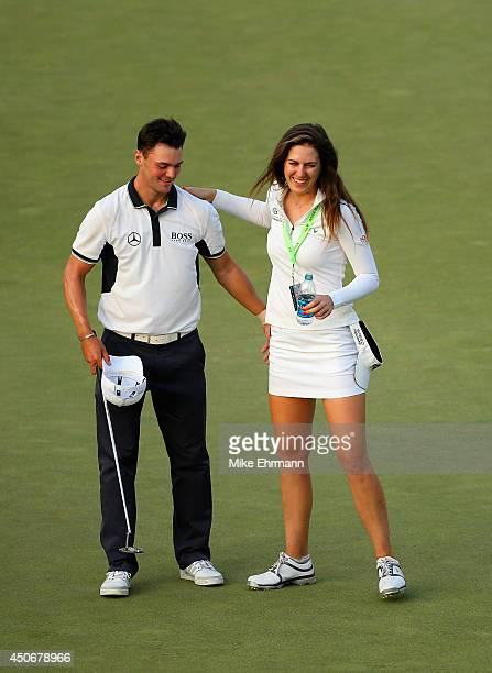 Martin Kaymer of Germany celebrates his eightstroke victory on the 18th green with LPGA player Sandra Gal of Germany during the final round of the...