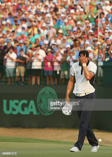Martin Kaymer of Germany celebrates his eight-stroke victory on the 18th green during the final round of the 114th U.S. Open at Pinehurst Resort &...