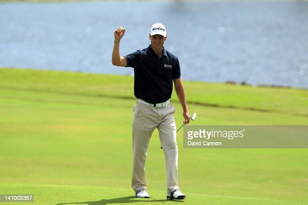 Martin Kaymer of Germany celebrates holing a long putt from off the green for an eagle 3 at the par 5 10th hole during the second round of the World...