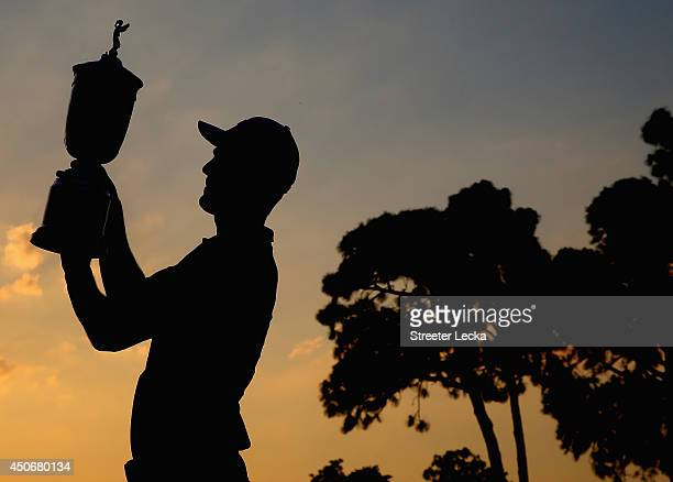 Martin Kaymer of Germany celebrates with the trophy after his eight-stroke victory during the final round of the 114th U.S. Open at Pinehurst Resort...