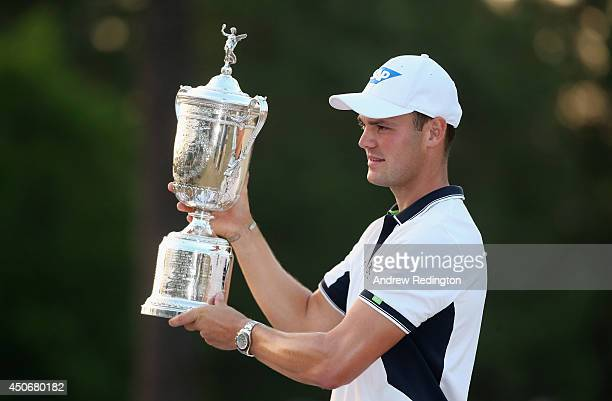 Martin Kaymer of Germany celebrates with the trophy after his eightstroke victory during the final round of the 114th US Open at Pinehurst Resort...