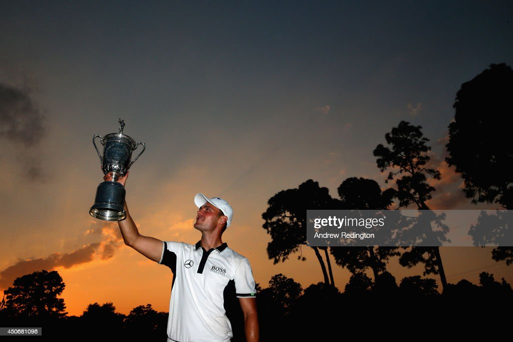 Martin Kaymer of Germany celebrates with the trophy after his eight-stroke victory during the final round of the 114th U.S. Open at Pinehurst Resort & Country Club, Course No. 2 on June 15, 2014 in Pinehurst, North Carolina.