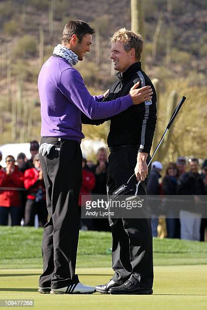 Martin Kaymer of Germany congratulates Luke Donald of England on his victory on the 16th hole during the final round of the Accenture Match Play...