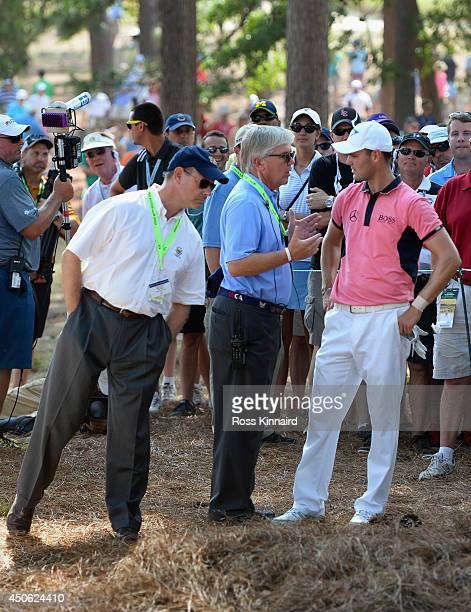 Martin Kaymer of Germany discusses his options with USGA Executive Director Mike Davis and USGA President, Thomas O'Toole, Jr. On the fourth hole...