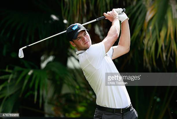 Martin Kaymer of Germany hits a shot during a practice round prior to the start of the World Golf Championships-Cadillac Championship at Trump...