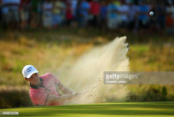 Martin Kaymer of Germany hits a shot from a greenside bunker on the tenth hole during the third round of the 114th US Open at Pinehurst Resort...