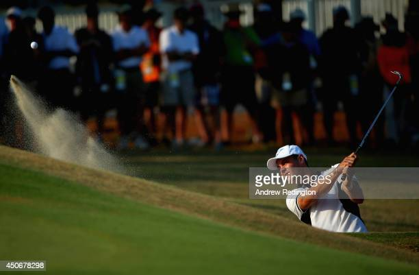 Martin Kaymer of Germany hits a shot from a greenside bunker on the 13th hole during the final round of the 114th U.S. Open at Pinehurst Resort &...