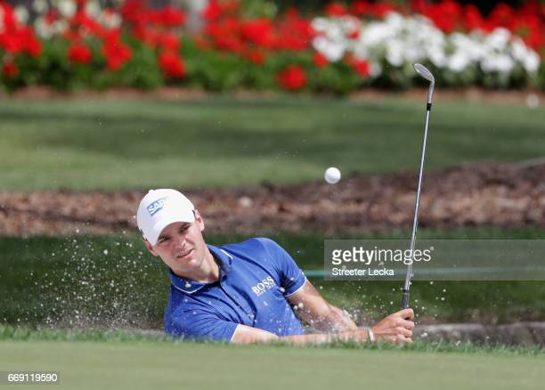 Martin Kaymer of Germany hits a shot from the sand on the 13th hole during the final round of the 2017 RBC Heritage at Harbour Town Golf Links on...