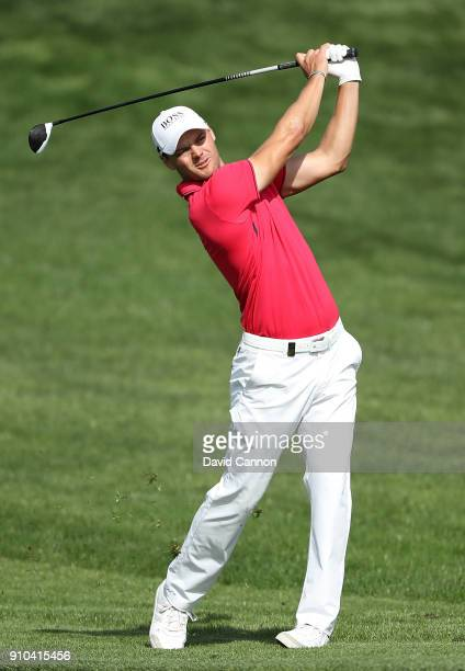 Martin Kaymer of Germany hits his second shot on the 10th hole during round two of the Omega Dubai Desert Classic at Emirates Golf Club on January 26...