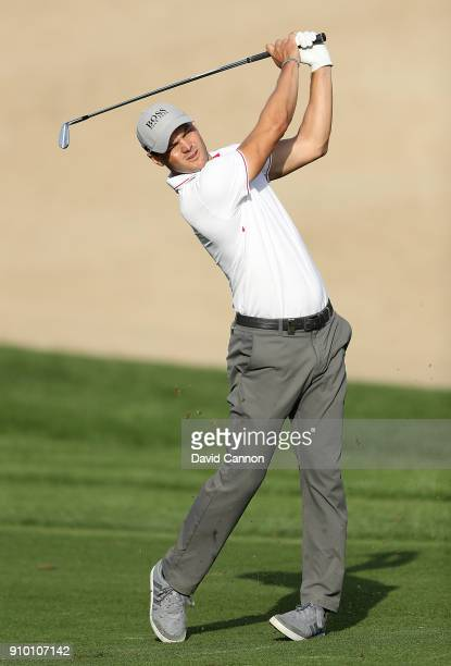 Martin Kaymer of Germany hits his second shot on the 14th hole during round one of the Omega Dubai Desert Classic at Emirates Golf Club on January 25...
