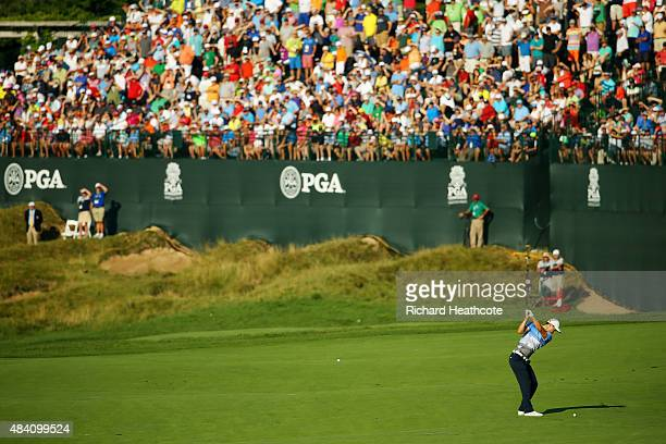 Martin Kaymer of Germany hits his second shot on the 18th hole during the continuation of the weather-delayed second round of the 2015 PGA...