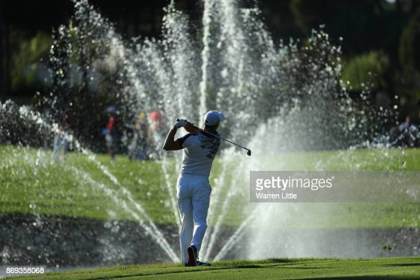 Martin Kaymer of Germany hits his second shot on the 18th hole during the first round of the Turkish Airlines Open at the Regnum Carya Golf Spa...