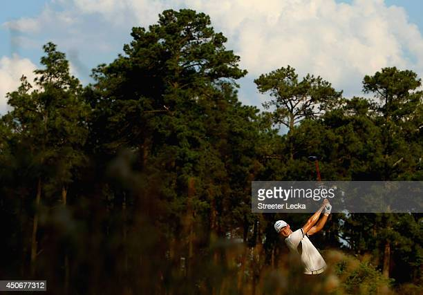 Martin Kaymer of Germany hits his tee shot on the 13th hole during the final round of the 114th U.S. Open at Pinehurst Resort & Country Club, Course...