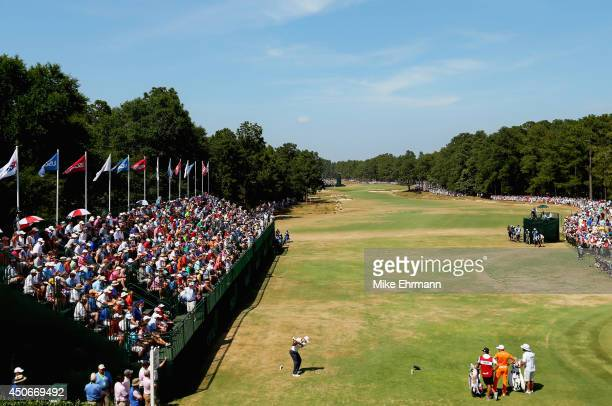 Martin Kaymer of Germany hits his tee shot on the first hole as Rickie Fowler of the United States looks on during the final round of the 114th US...