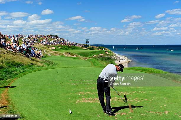 Martin Kaymer of Germany hits his tee shot on the seventh hole during the final round of the 92nd PGA Championship on the Straits Course at Whistling...