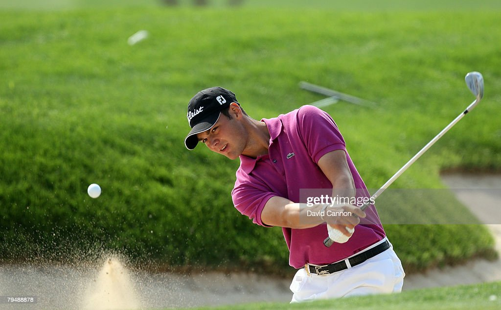 Martin Kaymer of Germany hits his third shot at the 6th hole during the final round of the Dubai Desert Classic, on the Majilis Course at the Emirates Golf Club, on February 3, 2008 in Dubai, United Arab Emirates.