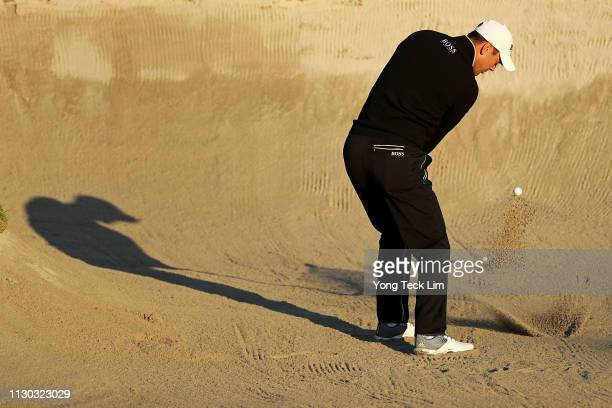 Martin Kaymer of Germany hits out of the bunker on the 2nd hole during the continuation of the third round of the Genesis Open at Riviera Country...