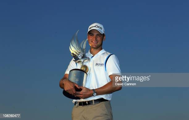 Martin Kaymer of Germany holds the trophy after winning the 2011 Abu Dhabi HSBC Golf Championship held at the Abu Dhabi Golf Club on January 23 2011...