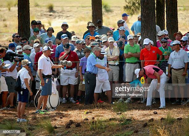 Martin Kaymer of Germany inspects his lie in the pine straw on the fourth hole during the third round of the 114th US Open at Pinehurst Resort...