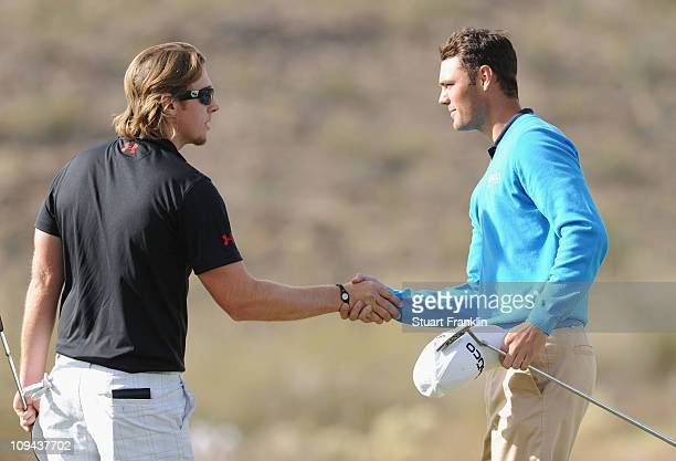 Martin Kaymer of Germany is congraulated by Hunter Mahan on the 17th hole during the third round of the Accenture Match Play Championship at the...