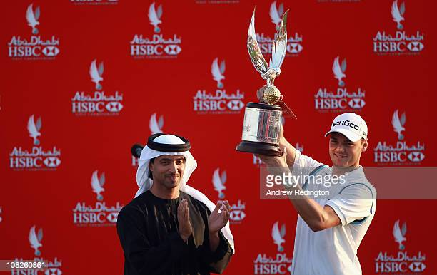 Martin Kaymer of Germany is presented with the trophy by His Highness Sheikh Hazza Bin Zayed Al Nahyan The National Security Advisor Vice Chairman of...