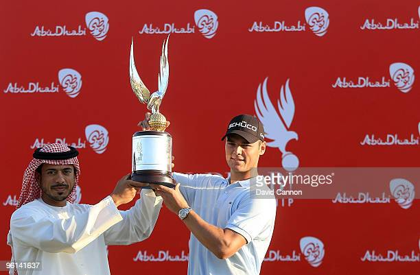 Martin Kaymer of Germany is presented with the trophy by Sheikh Sultan Bin Tahnoon Al Nahyan the Chairman of the Abu Dhabi Tourism Authority after...