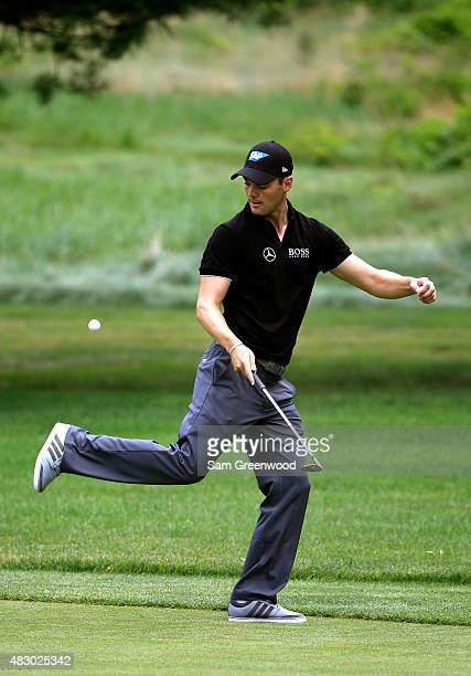 Martin Kaymer of Germany kicks a golf ball during a practice round for the World Golf Championship Bridgestone Invitational at Firestone Country Club...
