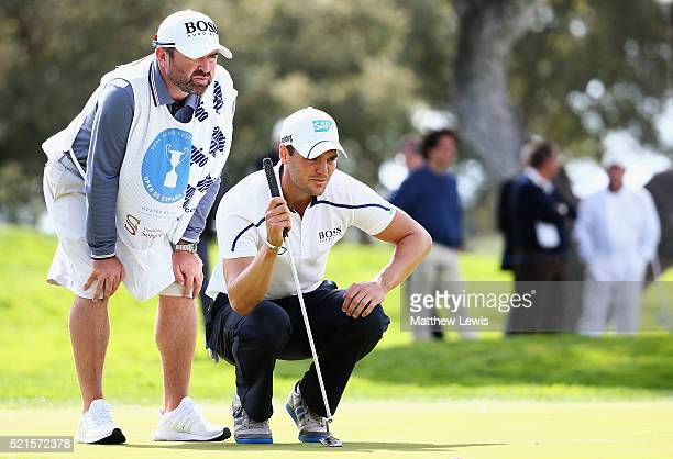Martin Kaymer of Germany lines up a putt with his caddie Craig Connelly during day three of the Open de Espana at Real Club Valderrama on April 16...