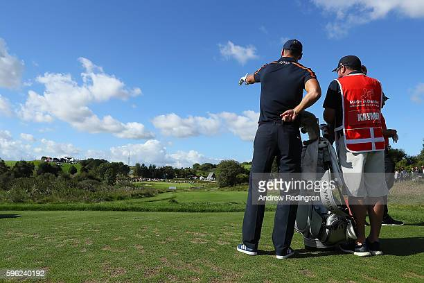 Martin Kaymer of Germany looks down the 2nd hole with caddie Craig Connelly during the third round of Made in Denmark at Himmerland Golf Spa Resort...
