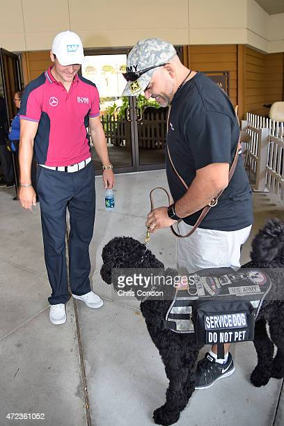 Martin Kaymer of Germany meets his namesake K9 Warrior Kaymer during practice for THE PLAYERS Championship on THE PLAYERS Stadium Course at TPC...