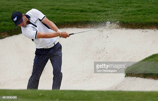 Martin Kaymer of Germany pitches out of the bunker on the eighth hole during Round Three of the HP Byron Nelson Championship at the TPC Four Seasons...