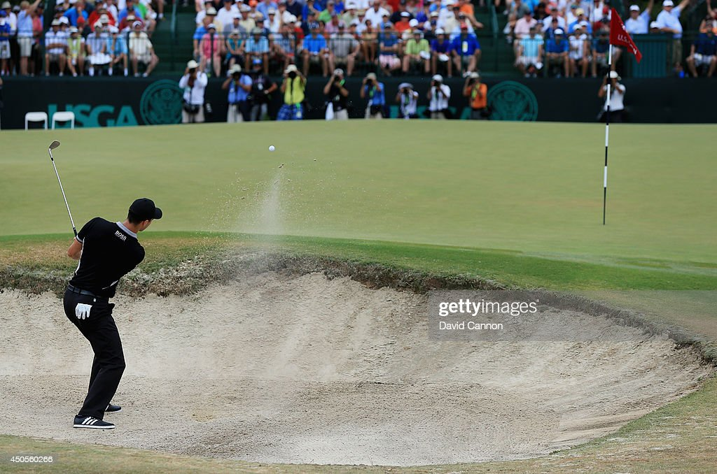Martin Kaymer of Germany plays a bunker shot on the seventh hole during the second round of the 114th U.S. Open at Pinehurst Resort & Country Club, Course No. 2 on June 13, 2014 in Pinehurst, North Carolina.