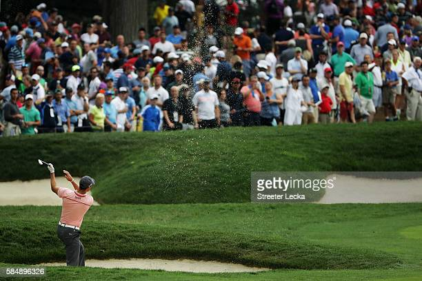 Martin Kaymer of Germany plays a shot from a fairway bunker on the fifth hole during the final round of the 2016 PGA Championship at Baltusrol Golf...