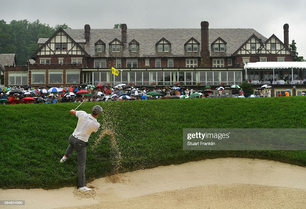 Martin Kaymer of Germany plays a shot from a greenside bunker on the 18th hole during the continuation of the weather delayed third round of the 2016 PGA Championship at Baltusrol Golf Club on July 31, 2016 in Springfield, New Jersey.