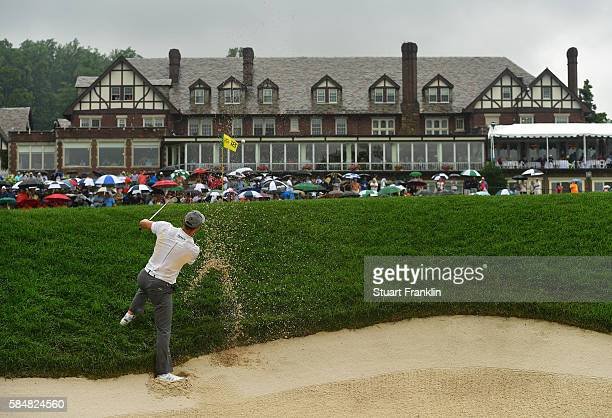 Martin Kaymer of Germany plays a shot from a greenside bunker on the 18th hole during the continuation of the weather delayed third round of the 2016...