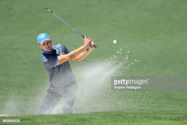 Martin Kaymer of Germany plays a shot from a greenside bunker on the second hole during the second round of the 2017 Masters Tournament at Augusta...