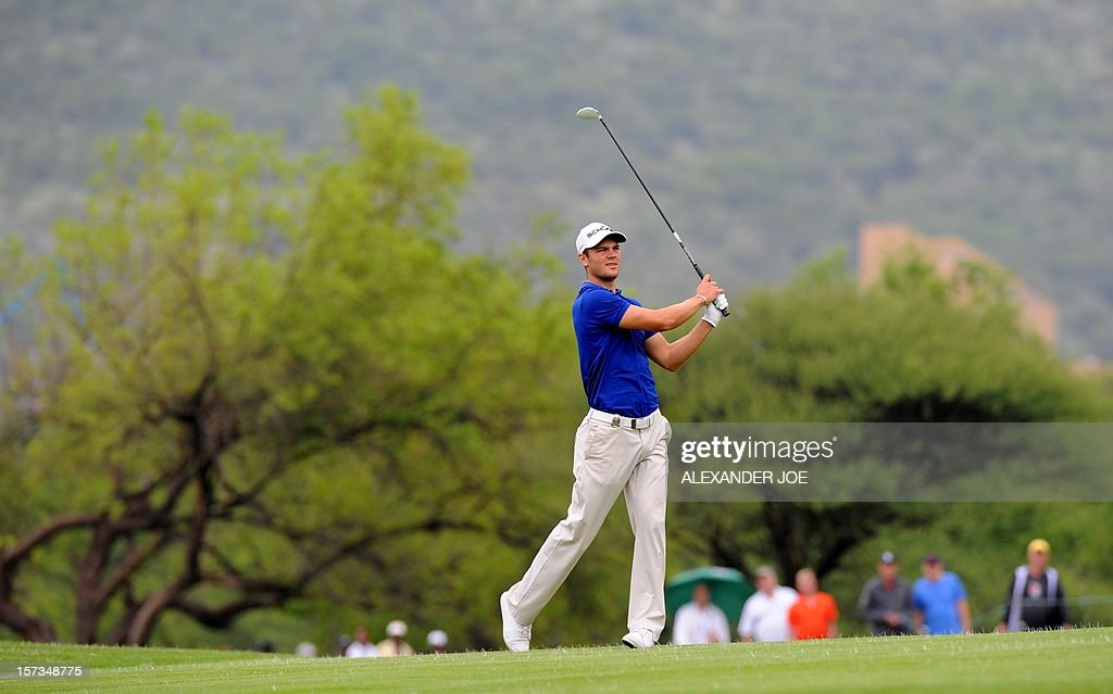 Martin Kaymer of Germany plays a shot on the second green during the 2012 Nedbank Golf Challenge in Sun City on December 2 ,2012 before claiming the 1.2 Million USD prize. PHOTO / Alexander Joe