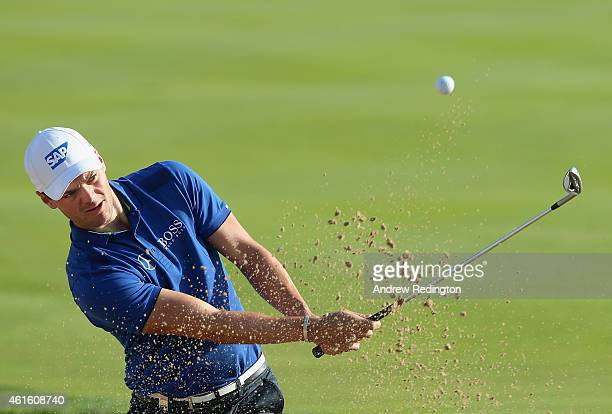 Martin Kaymer of Germany plays from a bunker on the 16th hole during the second round of the Abu Dhabi HSBC Golf Championship at the Abu Dhabi Golf...