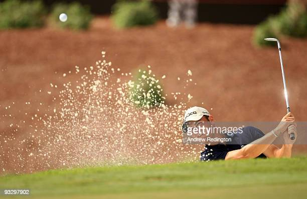 Martin Kaymer of Germany plays from a bunker on the 17th hole during the final round of the Dubai World Championship on the Earth Course Jumeirah...