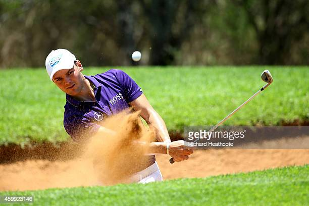Martin Kaymer of Germany plays from a greenside bunker on the 7th during the first round of the Nedbank Golf Challenge at the Gary Player Country...
