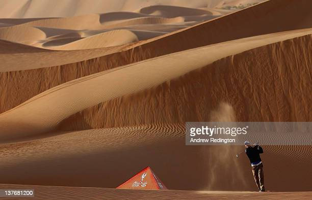 Martin Kaymer of Germany plays from amongst the 250ft high sand dunes in Abu Dhabi's Liwa Desert at the entrance to Rub Al Khali as a preview for the...