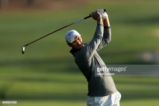 Martin Kaymer of Germany plays his second shot on the 10th hole during the second round of the 2018 Abu Dhabi HSBC Golf Championship at the Abu Dhabi...