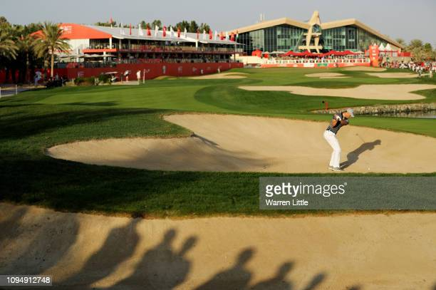 Martin Kaymer of Germany plays his second shot on the 18th hole during Day One of the Abu Dhabi HSBC Golf Championship at Abu Dhabi Golf Club on...