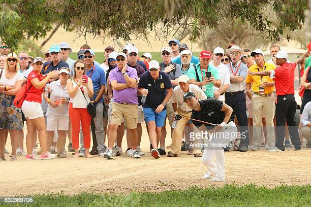 Martin Kaymer of Germany plays his second shot on the 8th hole during the final round of the Abu Dhabi HSBC Championship at Abu Dhabi Golf Club on...