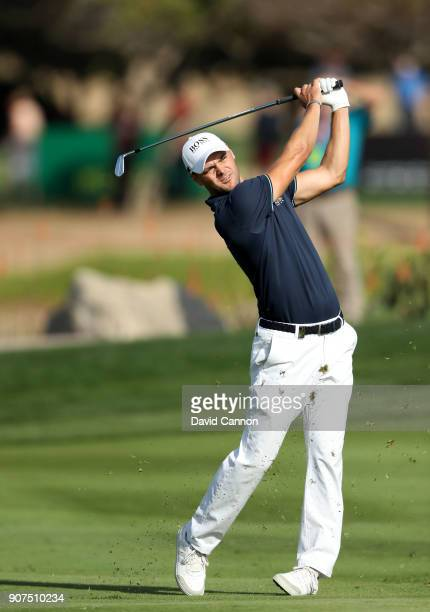 Martin Kaymer of Germany plays his second shot on the par 4 16th hole during the third round of the 2018 Abu Dhabi HSBC Golf Championship at the Abu...