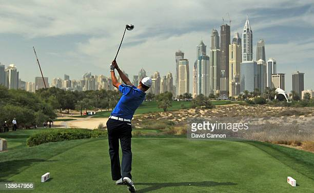 Martin Kaymer of Germany plays his tee shot at the par 4 8th hole during the second round of the 2012 Omega Dubai Desert Classic on the Majilis...